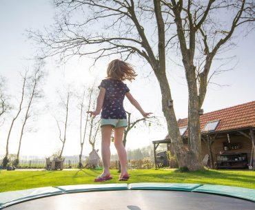 kid on a trampoline
